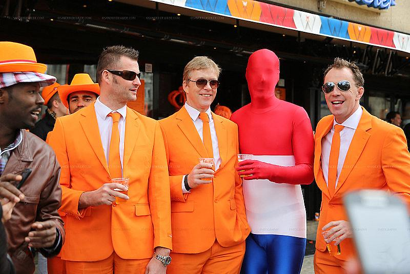 orange men drinking beer